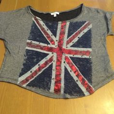 Gray Union Jack Tee Gently used & in great condition. Gray top with union jack. Red is shiny and there is stud detailing. Very cute. delias Tops Crop Tops
