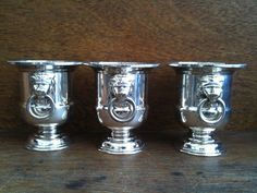 Vintage English silver plate trophy cups trophies trio with lion heads circa 1970's Purchase in store here http://www.europeanvintageemporium.com/product/vintage-english-silver-plate-trophy-cups-trophies-trio-with-lion-heads-circa-1970s/