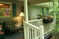 I have always liked the way lamps look on front porches! Makes it look so cozy and inviting.
