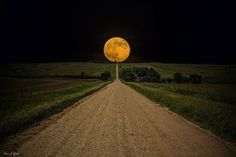 Supermoon rises over this road to nowhere in eastern South Dakota.  Copyright : Aaron J. Groen