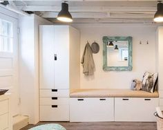 HGTV presents a fun art studio for kids in the low-ceiling basement of a Colonial. The transitional room features contemporary cabinets and furnishings, and the rafters were exposed and painted white to create a feeling of greater space. Ikea Kids, Low Ceiling Basement, Low Ceiling, Ikea, Mudroom, Home, Ikea Stuva, Mud Room Storage, Room