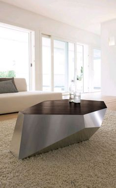 This spectacular modern coffee table is Diamante by Antonello Italia. The design is funky and futuristic, the combination of wood and metal fits perfectly in the modern home or commercial space.