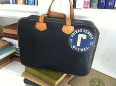 vintage leather carry-all with Italia cruise sticker