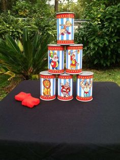 Tin Can Knock Down  Stack up cans and let guests throw bean bags to knock down the tower of cans.