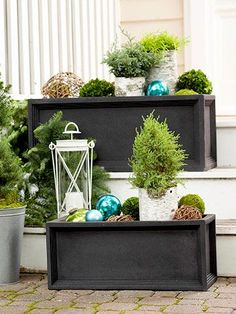 Instead of storing your planters for the winter months, use them to create a Christmas landscape. These winter-worthy composite planters serve as a base for an ensemble of small cypress plantings in birch-bark tubes. Fill in your display with moss, grapevine spheres, and oversize glass ornaments./
