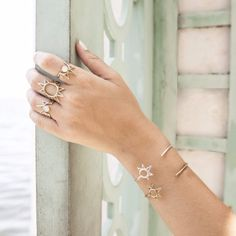 """Bring the brightest summer sun with you anywhere when you wear this handmade cuff. Dimensions: Measures 2.5"""" in diameter. Details: Brass or Sterling silver. Designer Allison Jenetopulos brings togethe"""