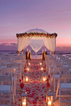 Thinking of planning a destination wedding? Our destination wedding guide has everything you need to plan your big day. Find the perfect wedding location and venue, and find expert destination wedding planning advice before you walk down the aisle. Night Beach Weddings, Beach Wedding Aisles, Wedding Aisle Decorations, Beach Ceremony, Wedding Ceremony, Wedding On The Beach, Beach Night, Romantic Beach Weddings, Sunset Wedding Theme
