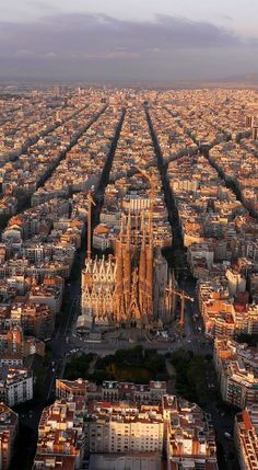 An aerial view of Barcelona, Spain. The The Eixample district has octagonal city blocks, designed to allow light and space on the street corners. Aerial Photography, Travel Photography, Travel Around The World, Around The Worlds, Places To Travel, Places To Visit, Travel Destinations, Reisen In Europa, Voyage Europe