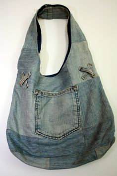 Recycled jean purse use pockets and also the loops