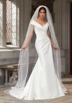 Stacey Wedding Dress The Stacey wedding gown features draped, stretch Larissa satin in a fit to flare silhouette. Shown in Ivory. Boho Wedding Dress With Sleeves, Mori Lee Wedding Dress, Off Shoulder Wedding Dress, Classic Wedding Dress, Bridal Wedding Dresses, Wedding Dress Styles, Dresses With Sleeves, Lace Wedding, Wedding Dress Not White