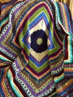 This striped afghan is a sampler of different crochet stitches. Made using random scraps of yarn it is a very colorful afghan.    It measures