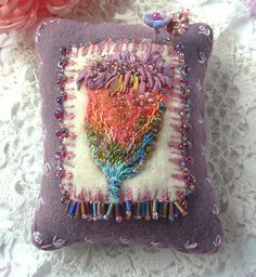 Wool Pincushion with Felting and embroidery, via Flickr.