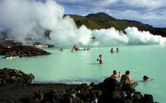 """The Blue Lagoon in Iceland. Called """"The Land of Fire and Ice"""" b/c you're swimming in mud waters while it snows."""