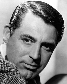 Cary Grant, obviously using a fine toothed comb for the side. And a hairbrush with boar bristles for the top. As hairstyling product, this looks like Vaseline Hair Tonic, which was extremely popular in the 1920-40s