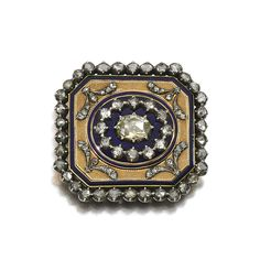 Enamel and diamond brooch, early 19th century. The textured cut-cornered plaque applied with royal blue enamel and highlighted rose diamonds mounted in cut-down collets.