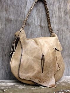 Love the ragged-raw detail of this asymetric  leather handbag