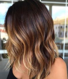 Sun kissed dark hair color