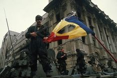 Bucharest, Romania --- Romanian soldiers man tanks in Bucharest's Palace Square, beside a Romanian flag with the Communist symbol torn from its center. --- Image by © Peter Turnley/CORBIS Romanian Flag, Romanian Revolution, Forest Light, Communism, Bucharest, World War I, Capital City, Revolutionaries, Past