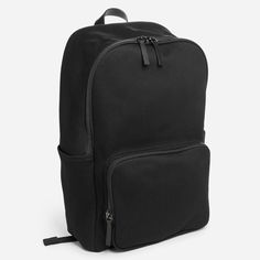 A throwback to the simplest of backpacks, this update brings modern features to a classic design Water-resistant cotton twill exterior Leather detailing Cotton/polyester lining YKK zippers Two side slip pockets for easy access to a water bottle, sunglasses, or other on-the-go items Spot clean only