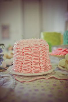 Pink frosted cake for tea party