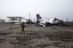 An armed man of the separatist self-proclaimed Donetsk People's Republic army stands near airplanes, damaged by months of fighting in the Donetsk airport , February 26, 2015. REUTERS/Baz Ratner