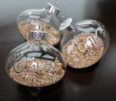 Family trip Maui sand and shells in an ornament with the date of each trip: http://www.completely-coastal.com/2012/12/beach-sand-ornaments.html