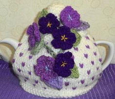 sweet violets ........ hand knitted and by peerietreisures on Etsy, £10.50