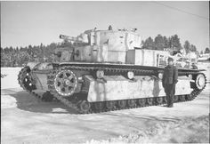 Tank photo. A Russian tank T-28 from the 20th Heavy Tank Brigade Kirov captured by Finnish troops in December 1939 .
