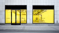 When designing this pop-up store for fashion brand Axel Arigato, Christian Halleröd brought colour to the minimal space with yellow windows and fur seats.