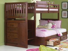 Our twin over full merlot staircase bunk bed is solidly constructed and stylishly designed to look great in any bedroom! This bunk bed sleeps two and has stairs with a built in four drawer chest for p
