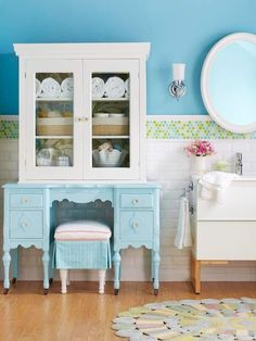 Wow can you imagine getting ready everyday in something this darling!  What a great idea for a vanity and cabinet space.