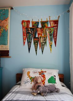 Love the vintage pennants. Great idea for a  boy's room.