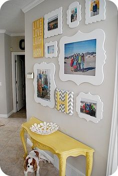 Photo wall with coordinating colors for the entryway or living room.