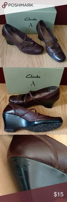 Clarks Artisan Wedge Dark brown wedge. Classic/Western very comfortable shoes, just a bit too big for me. A true 11. A scuff on the heel,as shown. Clarks Shoes Wedges