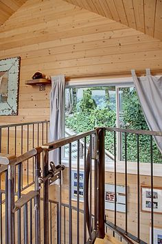 Simple and stunning home design with iron railings and cedar planked walls. Discovered on Porch.com