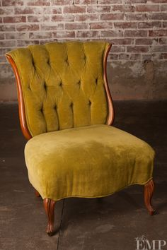 I am in love with the color, fabric, and just everythig about this chair.