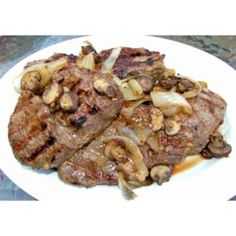 Honey, vinegar, garlic, ginger, oil and soy sauce are blended and then poured over flank steak. The meat sits in this tangy marinade overnight in the fridge, and emerges flavorful and very tender. Grill, slice, and serve.