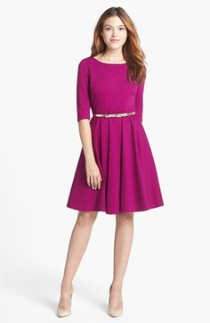 This is the perfect fit and flare dress because of the nice bright solid color, sleeves, belt and length