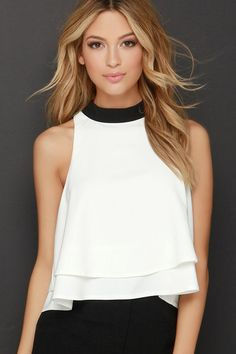 Maintain your polished, curated look with a tonal addition like the Fine-Tune Black and Ivory Crop Top! A high, rounded black collar is complemented by the lightweight woven ivory bodice that falls to a wide, sleeveless cut. The tiered hem adds plenty of movement and dimension. Back keyhole with two top clasps. Fully lined. 100% Polyester. Hand Wash Cold.