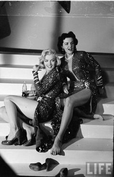 1953: Marilyn Monroe and Jane Russell taking a break between takes on the set of Gentlemen Prefer Blondes.