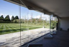Nearly frameless sliding folding doors to garden entertainment area