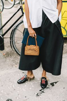 Street Style : sleeveless shirt paired with wide leg crops and slide || Saved by Gabby Fincham ||