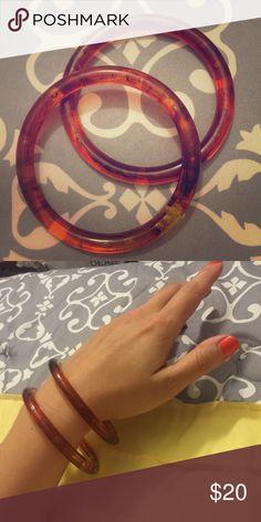 Vintage 2 Amber-colored bangle bracelets Vintage 2 Amber-colored bangle bracelets sooo pretty with pretty swirls and bubbles inside  plastic average sized. Very good vintage condition Vintage Jewelry Bracelets