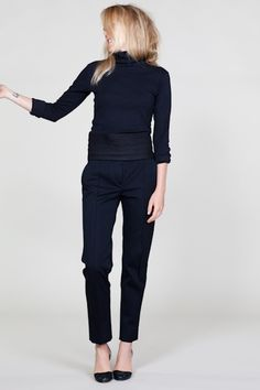 Black on black outfit for work and play. Black turtleneck, black tailored trousers / pants and black simple heels.