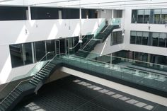 Structural steel staircase  walkway featuring glass balustrade with stainless steel handrail