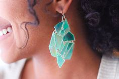 DIY - kaleidoscope earrings.  the design , shapes are endless...