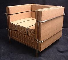 """The cardboard version of le Corbusier's """"le Gran Confort"""" club chair. Completely made of recycled materials; used cardboard, nylon strapping, and rusted, forgotten steel, welded for the frame. Cardboard Chair, Diy Cardboard Furniture, Paper Furniture, Cardboard Design, Cardboard Crafts, Recycled Furniture, Furniture Making, Furniture Design, Cardboard Boxes"""