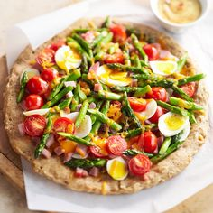 Spring Breakfast Pizza: Start your day off right with this savory veggie-topped breakfast pizza.