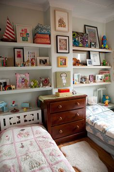 Shelves for shared kids room - perfect! Like the timber layer on top of each shelf.