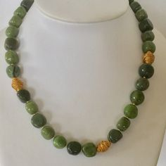 Greenery....jade nuggets and wrapped golden elements...